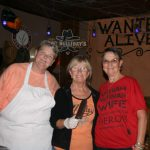 Kerry, Cindy, and Judi serving up the food